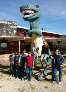 Students on Field Trip with tall dinosaur.